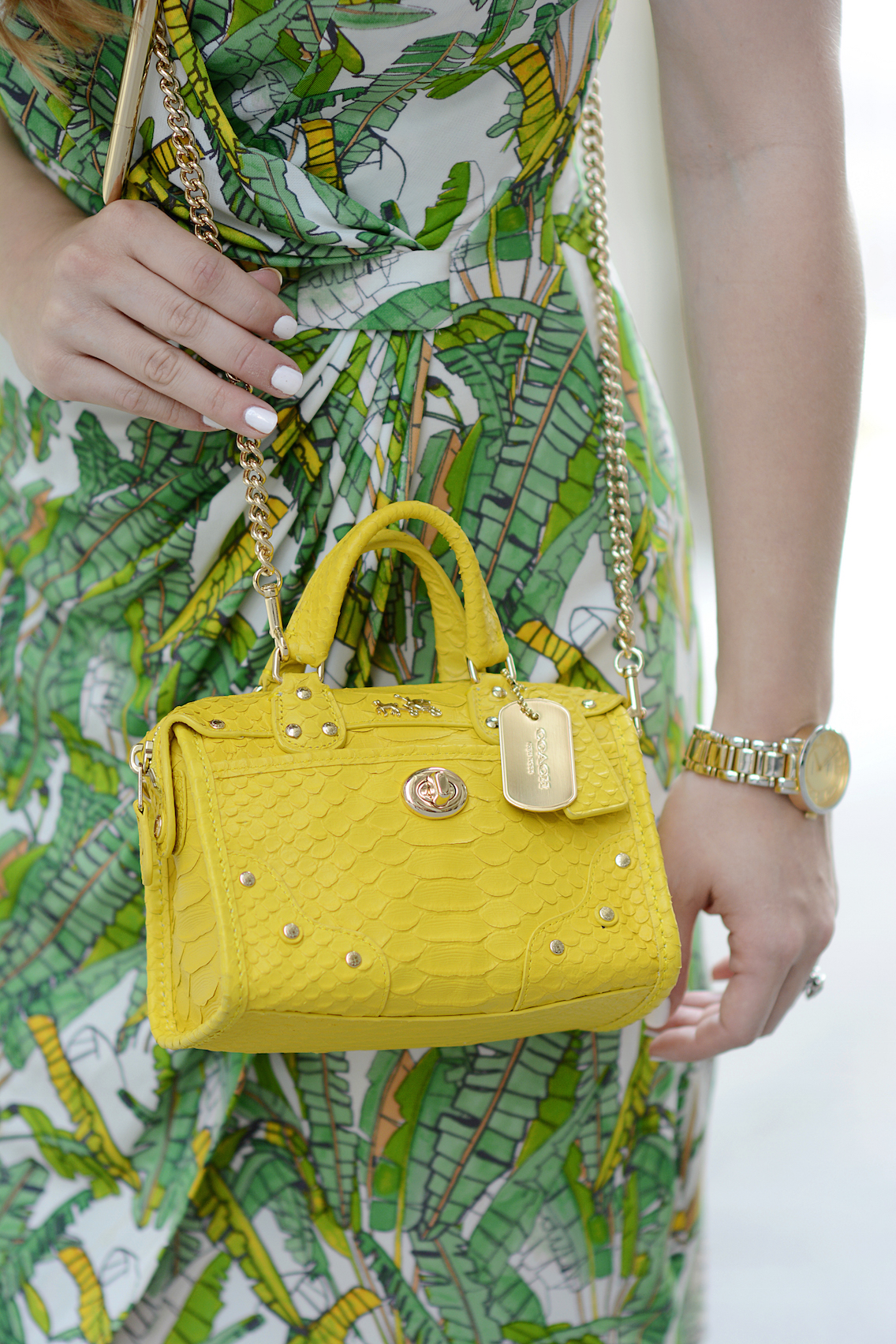 Coach Rhyder 18 crossbody bag in python embossed yellow leather